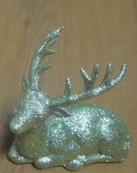 Rena dourada deitada Natal